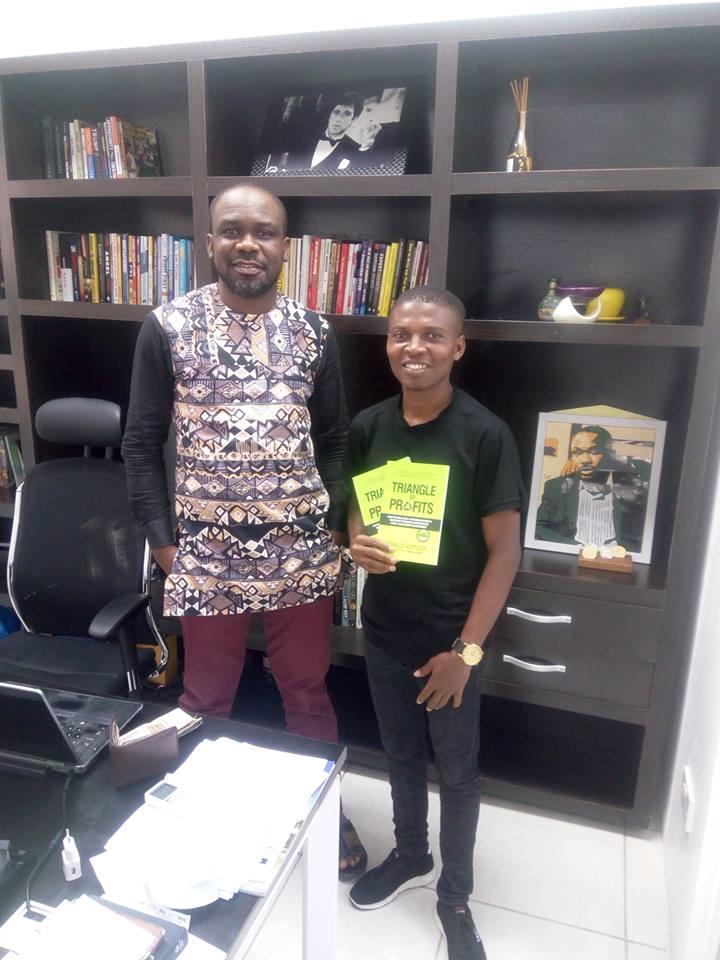 Emenike Emmanuel with Ronald Ikenna Nzimora holding Triangle of Profits