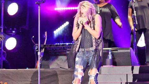 Carrie Underwood running a harmonica music as a business